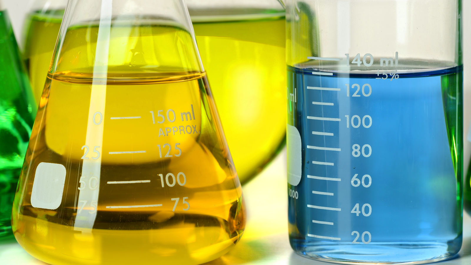 Colorful Chemicals measured in cylinders and beakers