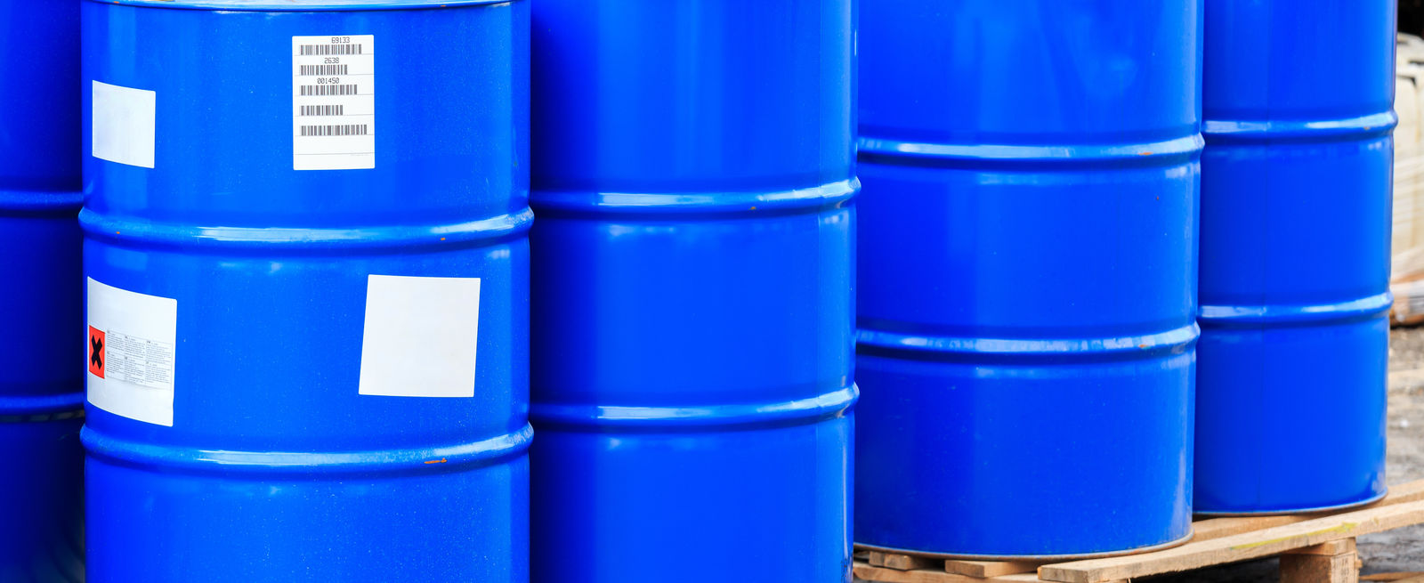 chemical barrels loaded on pallets in warehouse