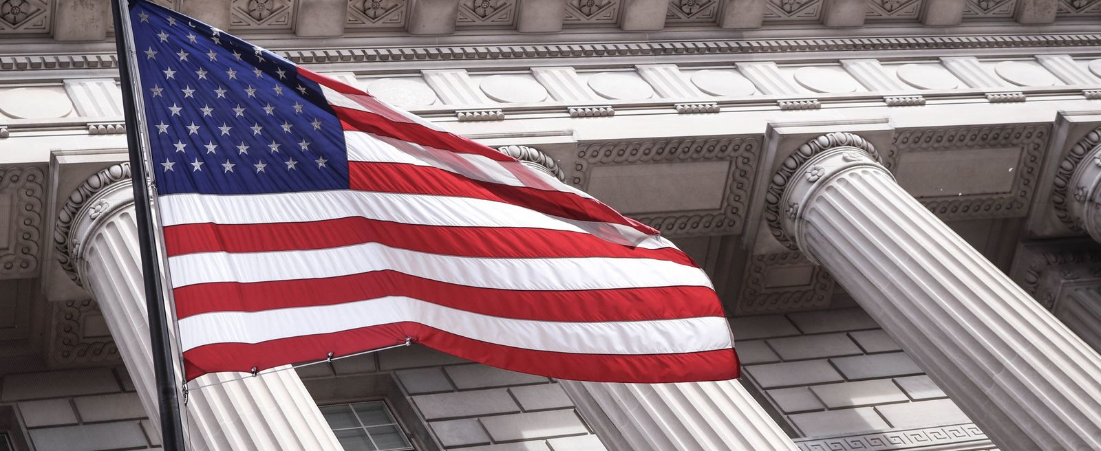 US department of commerce building with american flag