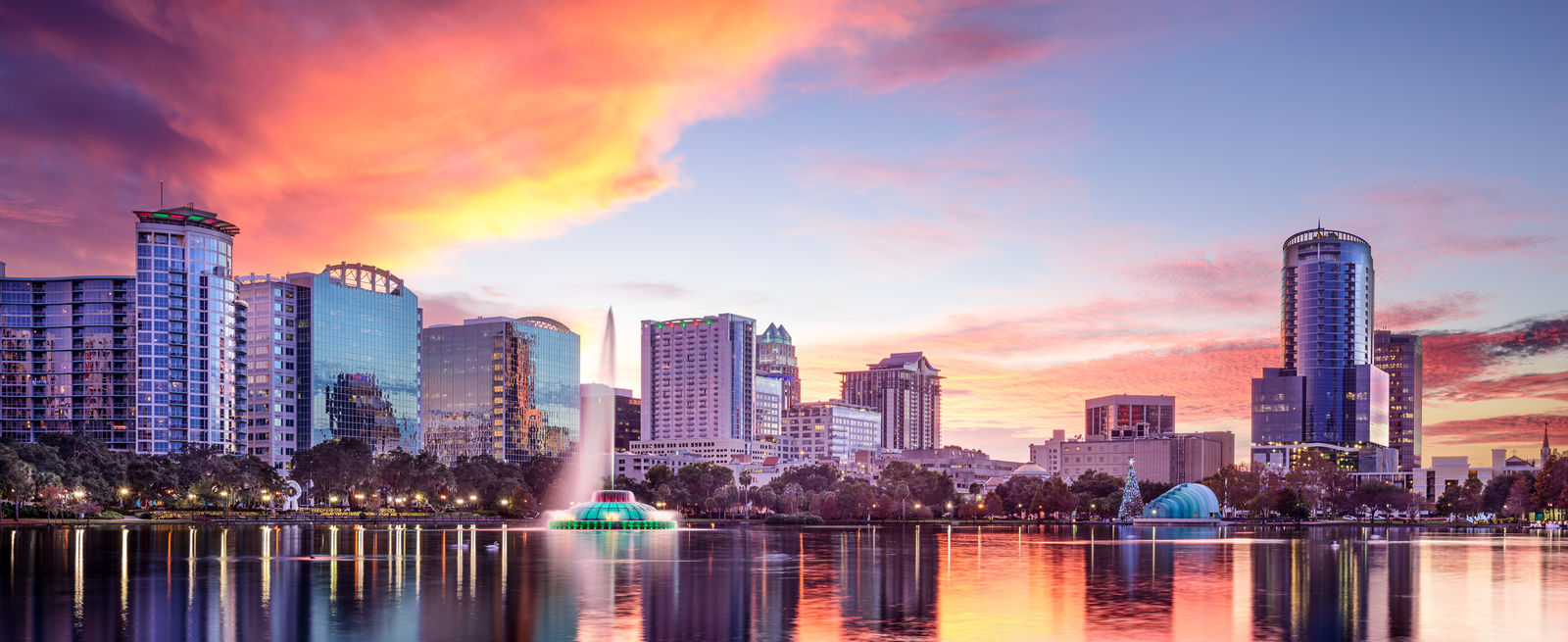 Orlando Florida city scape over water at sunset